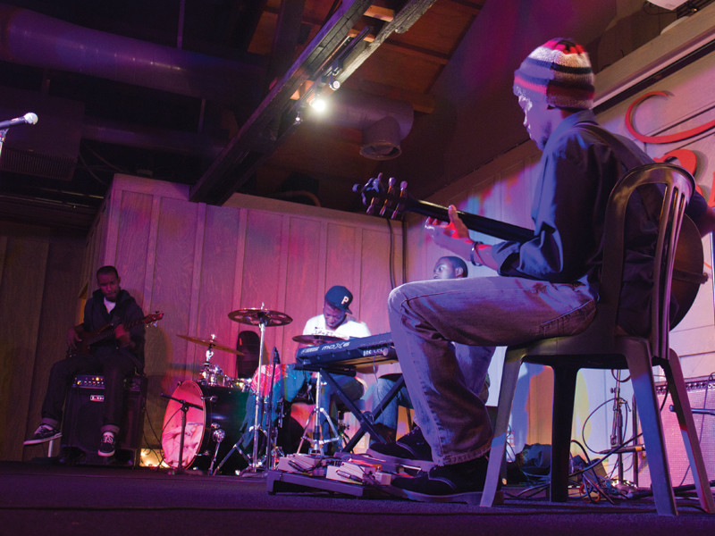 """The band Ultrasound plays their instrumental rendition of """"September"""" by Earth, Wind and Fire. They were the opening performer for the event and played soulful grooves that kept the audience wanting more. Courtesy of Wesley Ng"""