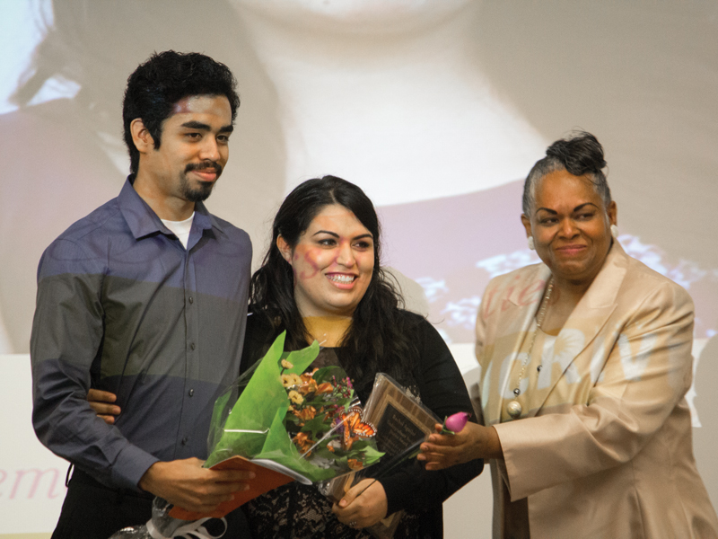 Social Justice Award honoree, Rachel Aguilar, receives flowers from her presenter Roberto Corella, and Director of Women's Resource Center, Adrienne Sims. Courtesy of Jie Huang