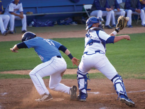 Ryan Lillie (No. 36) nearly misses the tag to get the runner out at home.