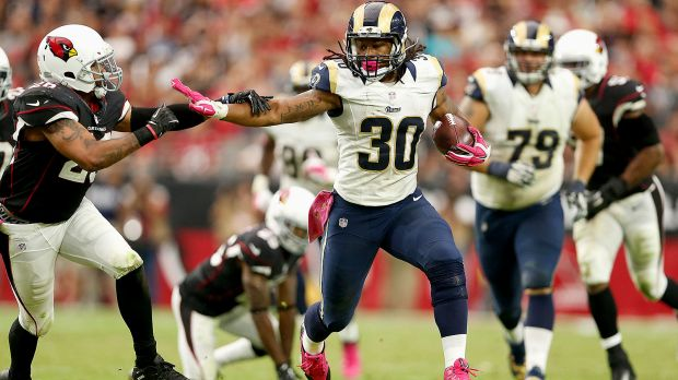Rams RB Todd Gurley stiff arms defender. (Courtesy of Fox Sports)