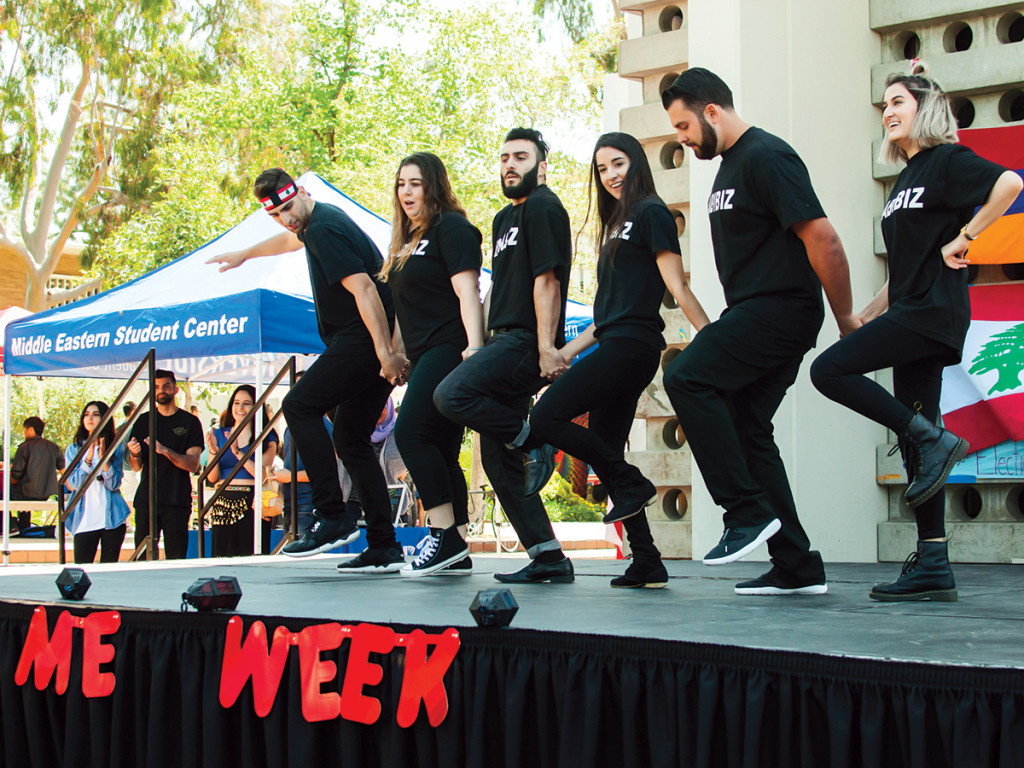 Members of UCR's Lebanese Social Club perform a lively folk dance called Dabke during the Middle Eastern Week Nooner. The club also welcomed members of the audience to join them and taught the Dabke dance to fellow UCR students. Janine Ybanez/HIGHLANDER
