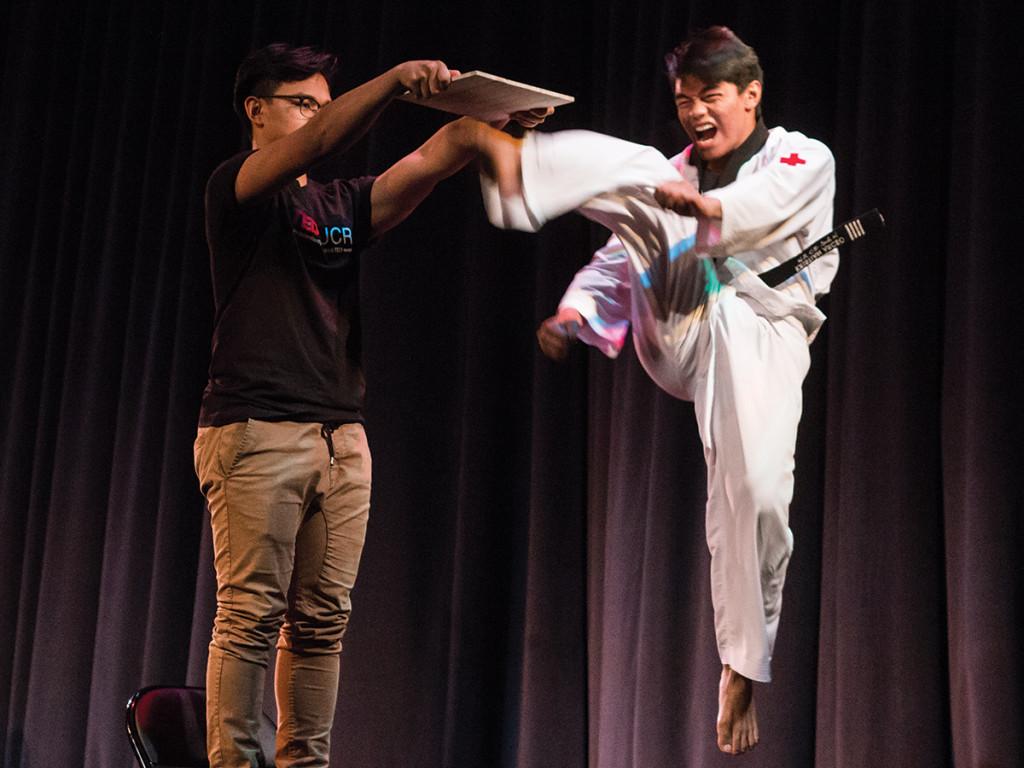 Martin Arceo demonstrates his black belt in taekwondo with a high kick. Aaron Lai/HIGHLANDER