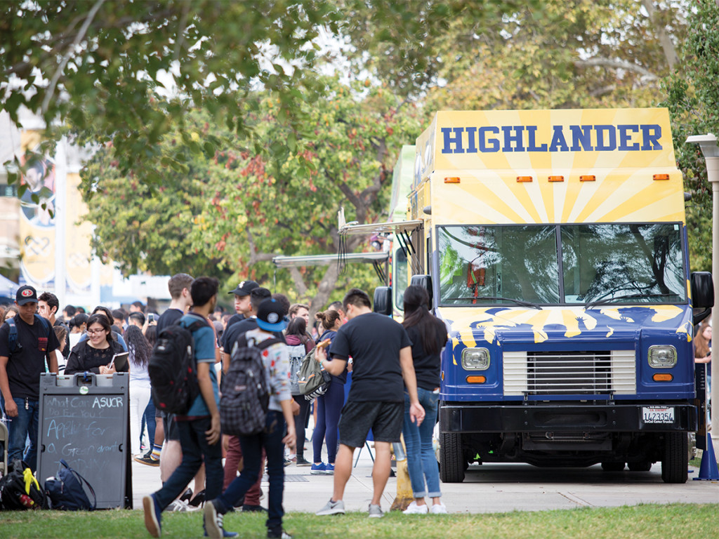 Students excitedly line up outside of the various food trucks at the bi-annual Food Truck Festival.