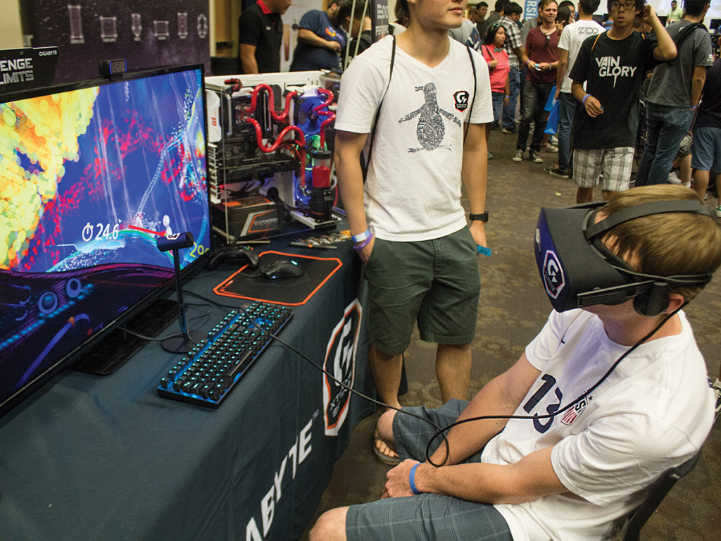An event-goer tries out the GeForce GTX 1070 gaming system.