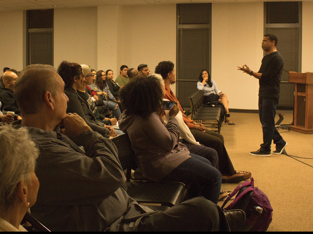 Adrian Dizon/HIGHLANDER UCR Professor of Playwright for Theater, Film and Theater Production Rickerby Hinds reignites attention from the crowd after it was announced the film would not continue to be screened with a personal dialogue on racial discrimination.