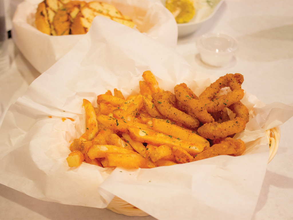 Cajun fries and fried calamari from Holy Crab Catherine Yong/HIGHLANDER
