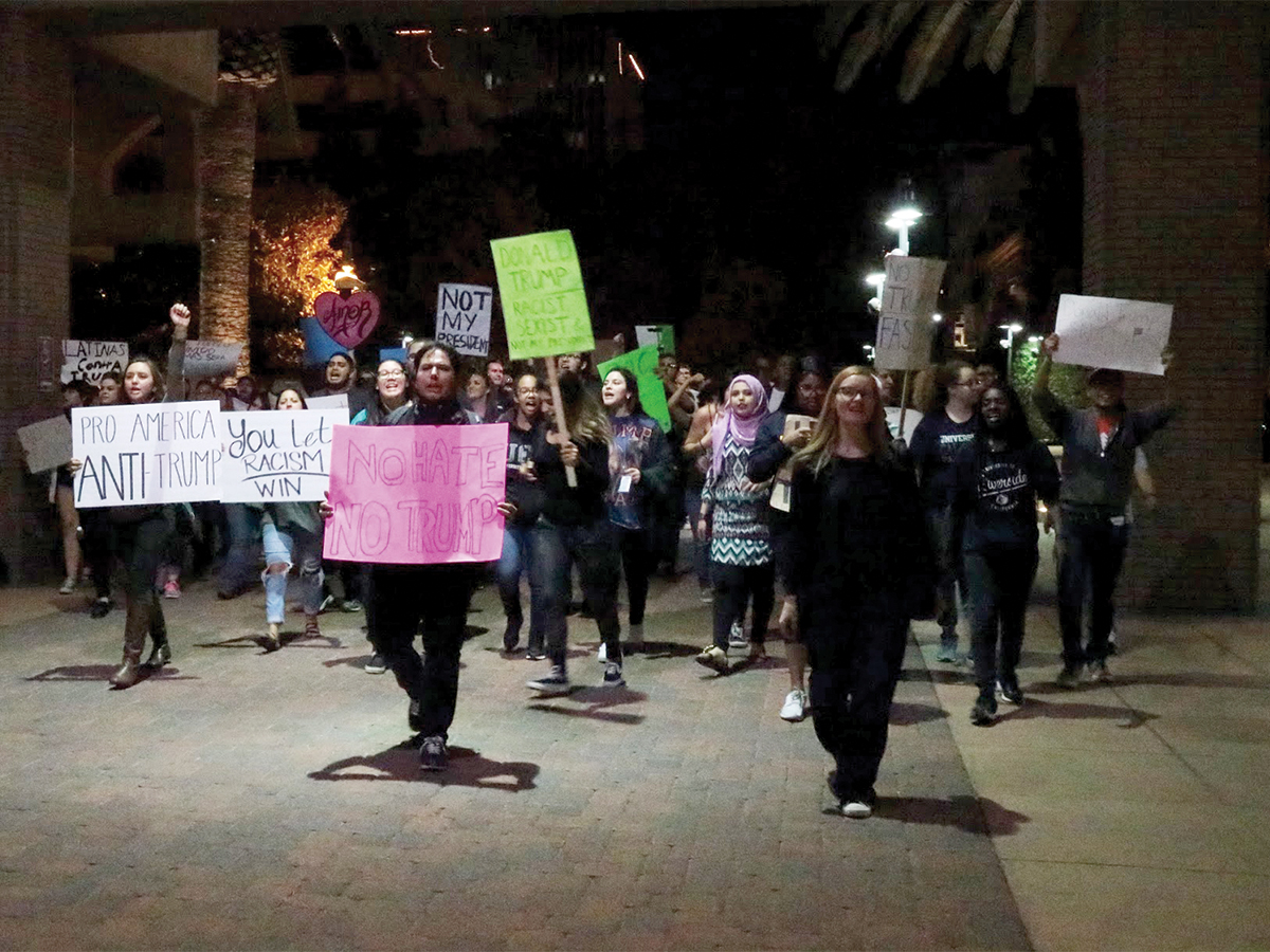 Protesters marched through streets of downtown Riverside in response to Donald Trump's election. (Faraz Rizvi/HIGHLANDER)
